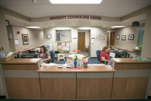 Amberkay Crotts (left) student employee, and Lisa Moore, administrative assistant, serve to welcome students and others in the UND community to the Counseling Center inside McCannel Hall.